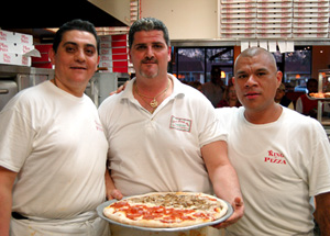 Mario Scaturro and King of Pizza employees